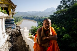 Novice monk at the top of Phousi Hill in Laos