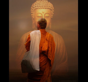 Monk in front of Buddha statue